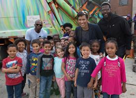 Photo of Mayor Muriel Bowser with a group of children